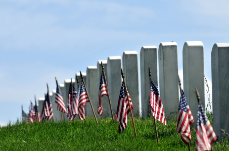 Gravestones decorated with U.S. flags to commemorate Memorial Da