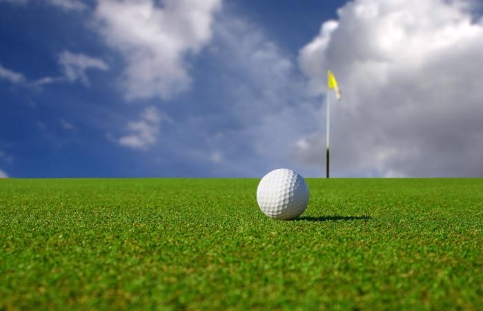 Close-up Of A Golf Ball On A Green